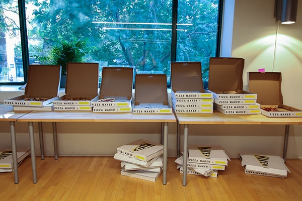 table of 20 pizza boxes